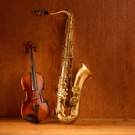 Classic music Sax tenor saxophone violin  in vintage wood background photo