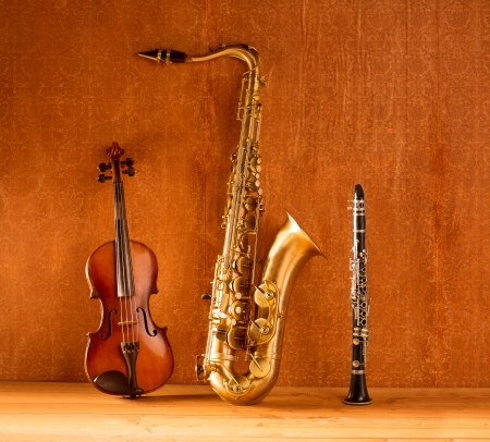 instruments: Classic music Sax tenor saxophone violin and clarinet in vintage wood background Stock Photo