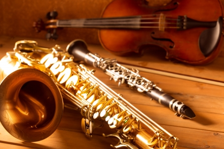 stringed: Classic music Sax tenor saxophone violin and clarinet in vintage wood background Stock Photo