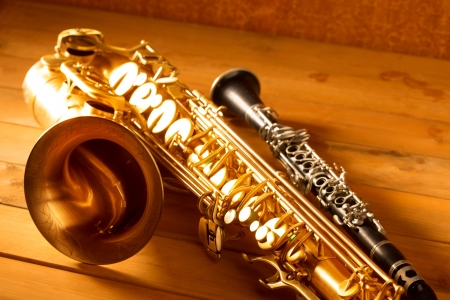 Classic music Sax tenor saxophone and clarinet in vintage wood background photo