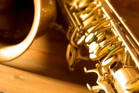 brass instrument: Sax golden tenor saxophone in vintage retro background Stock Photo