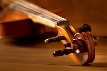 Classic music violin vintage in wooden golden background Stock Photo - 17608976