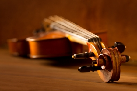 Classic music violin vintage in wooden golden background Stock Photo - 17608936
