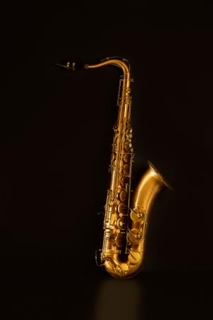 tenor: Sax golden tenor saxophone in black background Stock Photo