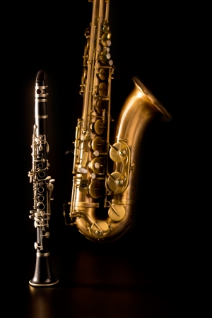 the tenor: Classic music Sax tenor saxophone and clarinet in black background