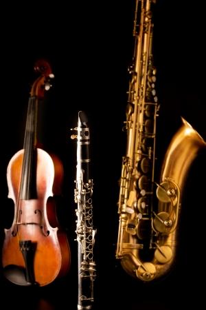 tenor: Music Sax tenor saxophone violin and clarinet in black background