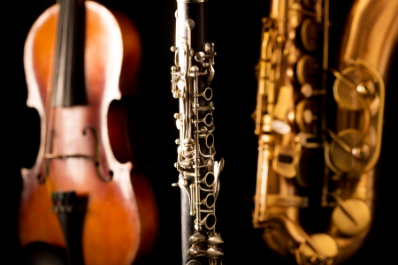 Music Sax tenor saxophone violin and clarinet in black background Stock Photo - 17608158
