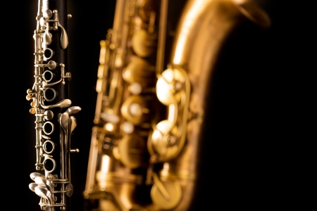 Classic music Sax tenor saxophone and clarinet in black background photo