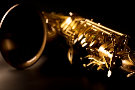 Tenor sax golden saxophone macro with selective focus on black photo