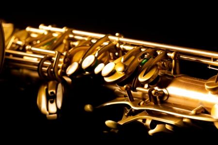 tenor: Tenor sax golden saxophone macro with selective focus on black