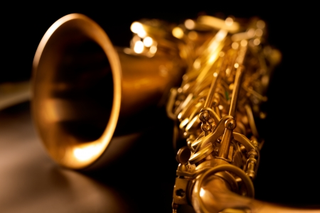 brass band: Tenor sax golden saxophone macro with selective focus on black