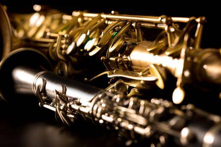 tenor: Classic music Sax tenor saxophone and clarinet in black background