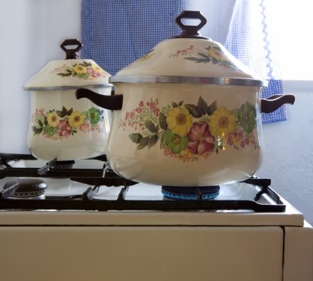 galley: Retro vintage kitchen with pots pans with porcelain flowers