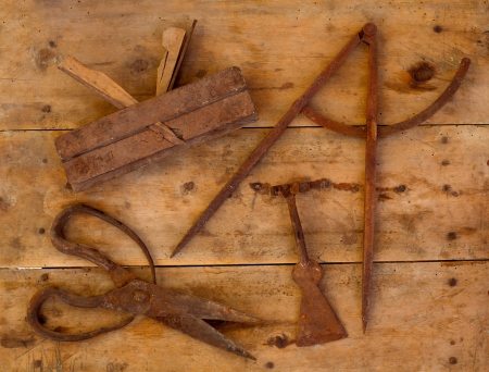 made to measure: Aged rusted traditional tools wood planer wool scissors drawing compass on retro wood