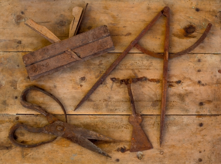 Aged rusted traditional tools wood planer wool scissors drawing compass on retro wood photo