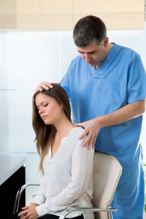 physiotherapist doing myofascial therapy on woman patient in hospital Stock Photo - 19636956