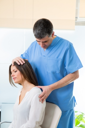 physiotherapist doing myofascial therapy on woman patient in hospital Stock Photo - 19636955