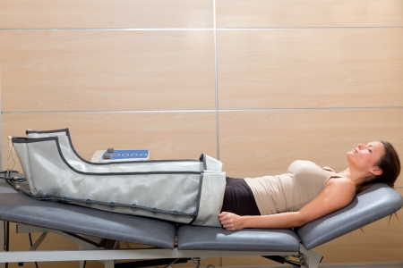 legs pressotherapy machine on woman patient in hospital bed photo
