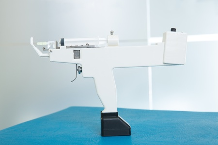 fat burning: mesotherapy gun electronic with syringe profile side view