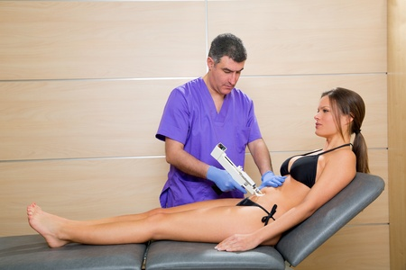 latex woman: abdominal mesotherapy gun therapy doctor to beautiful woman