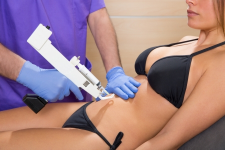 abdominal mesotherapy gun therapy doctor to beautiful woman Stock Photo - 19637019