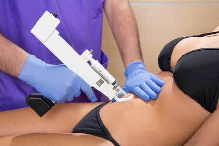 fat burning: abdominal mesotherapy gun therapy doctor to beautiful woman