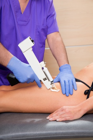 mesotherapy gun therapy for cellulite doctor with woman leg thigh photo