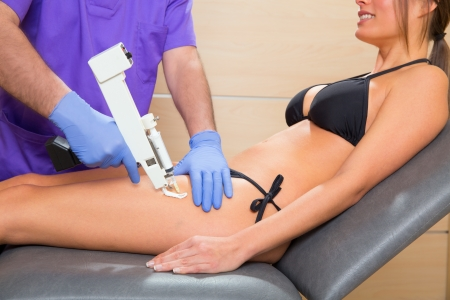 mesotherapy gun therapy for cellulite doctor with woman leg thigh Stock Photo - 19637022