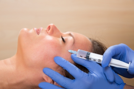 aging face: Anti aging facial mesotherapy with syringe closeup  on woman face