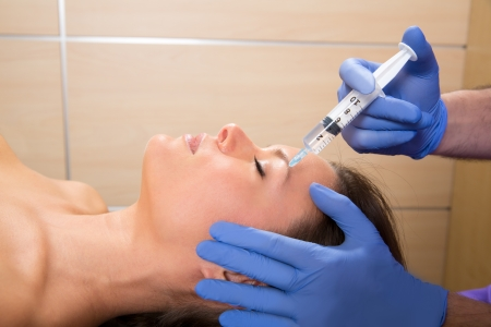 latex woman: Anti aging facial mesotherapy with syringe closeup  on woman face