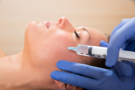 anti wrinkles: Anti aging facial mesotherapy with syringe closeup  on woman face