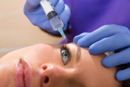 Anti aging facial mesotherapy with syringe closeup for face eye wrinkles photo