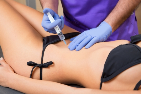 latex girl: abdominal mesotherapy therapy doctor to beautiful woman