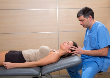 osteopathy: cranial osteopathy therapy doctor hands in woman head at hospital