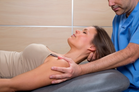 cervical stretching therapy with therapist doctor hands in woman neck Stock Photo - 19637037