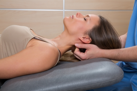 suboccipital massage therapy to woman with doctor therapist hands Stock Photo - 19615021