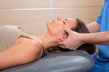 alternative healer: facial reflexology doctor hands in woman face therapy profile view Stock Photo