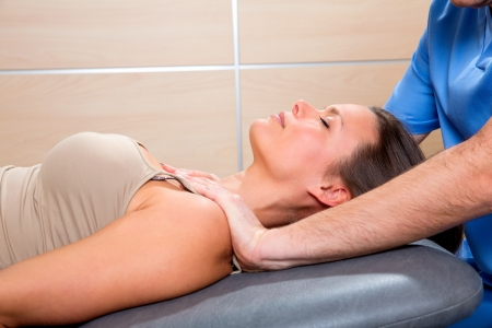 myofascial: Myofascial therapy technique with therapist hands in woman shoulders Stock Photo