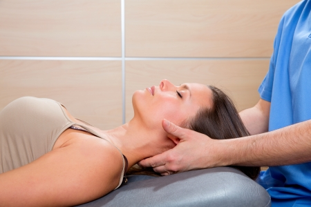 therapist: suboccipital massage therapy to woman with doctor therapist hands Stock Photo
