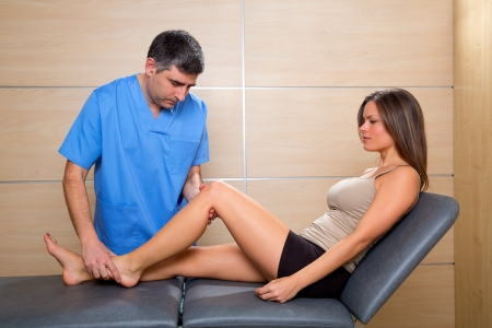 man legs: knee examination doctor therapist to woman patient in hospital