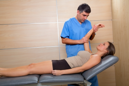 Shoulder physiotherapy doctor therapist and woman patient at hospital photo