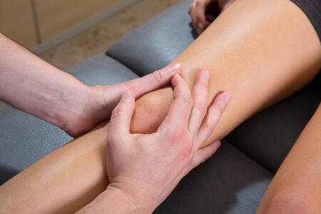 Maitland knee therapy massage on woman leg by therapist hands Stock Photo - 19616568
