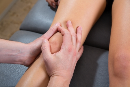 Maitland knee therapy massage on woman leg by therapist hands Stock Photo - 19616601