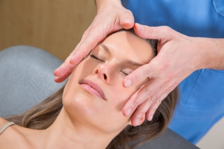 facial massage relaxing therapy on woman face with therapist hands Stock Photo - 19636987