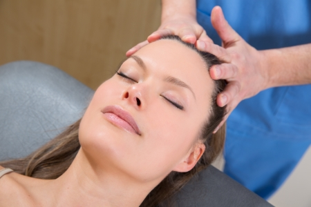 facial massage relaxing therapy on woman face with therapist hands Stock Photo - 19636978