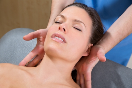 myofascial therapy on beautiful woman shoulders by therapist hands Stock Photo - 19636977