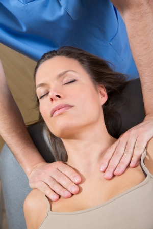 myofascial: myofascial therapy on beautiful woman shoulders by therapist hands Stock Photo