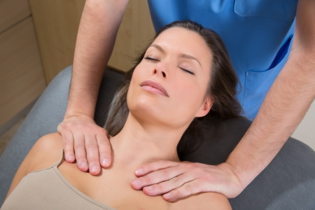 myofascial therapy on beautiful woman shoulders by therapist hands Stock Photo - 19636982
