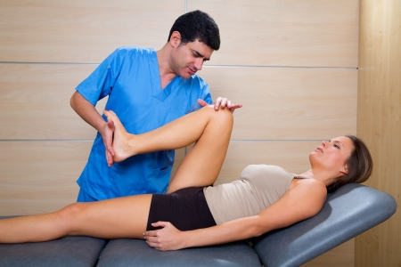 mobilization: hip mobilization therapy by physiotherapist in hospital to beautiful woman