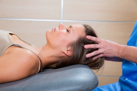 massage therapy: Massage therapy on cranial hear area by therapist to a beautiful woman